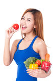 Young woman holding basket of vegetables. Stock Images