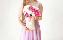 Young woman holding beautiful peonies. On white background Stock Photography