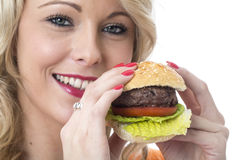 Young Woman Holding Beef Burger and Smiling Stock Photo