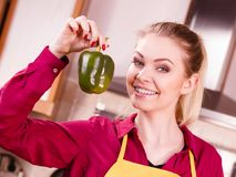 Woman holding bell pepper paprika thinking royalty free stock image