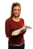 Young Woman Holding Bible. Beautiful young woman holding bible and pointing to verse royalty free stock photos