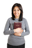 Young woman holding a bible showing commitment Royalty Free Stock Photography
