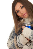 Young woman holding big blue cup Royalty Free Stock Images
