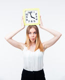 Young woman holding big clock Royalty Free Stock Photography