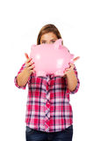Young woman holding big piggybank Royalty Free Stock Photo