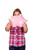 Young woman holding big piggybank Royalty Free Stock Photo