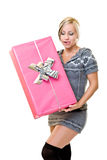Young woman holding a big pink gift Royalty Free Stock Photo