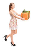 Young woman holding a big present Royalty Free Stock Photos
