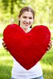 Young woman holding big red heart Royalty Free Stock Image