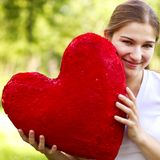 Young woman holding big red heart Royalty Free Stock Images