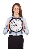 Young woman holding a round clock Royalty Free Stock Image
