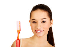 Young woman holding big toothbrush. Stock Images