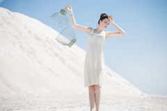 Young woman holding the bird cage Royalty Free Stock Photo