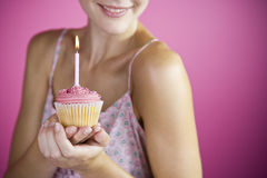 A Young Woman Holding A Birthday Cake With A Candle Royalty Free Stock Photography