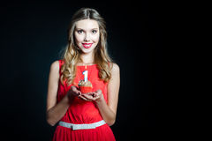 Young woman holding birthday cupcake Royalty Free Stock Images