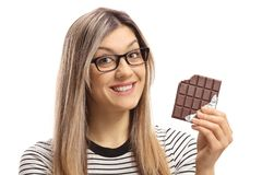 Young woman holding a bitten chocolate bar and smiling Royalty Free Stock Photo