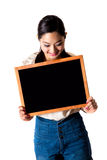 Young woman holding Black board Royalty Free Stock Image