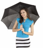 Young woman holding a black umbrella Royalty Free Stock Images