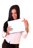 Young woman holding a blank. Portrait of a beautiful young brunette woman holding a blank billboard Stock Image
