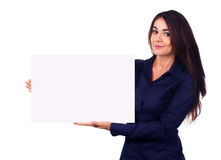 Young woman is holding blank banner, isolated over white Royalty Free Stock Photo