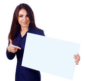 Young woman is holding blank banner, isolated over white Stock Photo