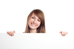 Young woman holding blank billboard Stock Image