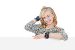 Young woman holding a blank billboard isolated Royalty Free Stock Photography