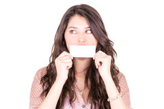 Young woman holding a blank business card in front Royalty Free Stock Image