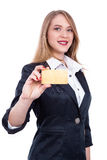 Young Woman Holding Blank business card in a hand - Stock Image Stock Photo