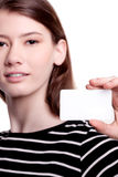 Young woman holding blank business card Royalty Free Stock Photography