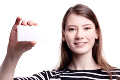 Young woman holding blank business card Stock Images