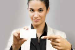 Young woman holding blank card Stock Images