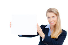 Young woman holding at blank card in her hand Royalty Free Stock Images