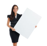 Young woman holding at blank card in her hand Stock Photography