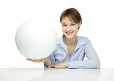 Young woman holding a blank globe stock photo