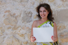 Young Woman Holding Blank Paper Stock Image