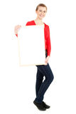 Young woman holding blank poster Stock Images