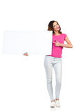 Young Woman Holding Blank Poster And Pointing Royalty Free Stock Photos