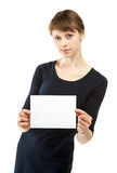 Young woman holding blank sheet of paper Stock Photos