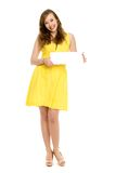 Young woman holding blank sign Stock Photos