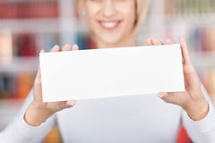 Young Woman Holding Blank Sign In Library Stock Image