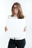 Young woman holding a blank sign Royalty Free Stock Photography