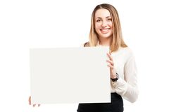 Young woman holding blank signboard. Royalty Free Stock Image