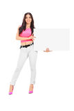 Young woman holding a blank white cardboard Royalty Free Stock Image