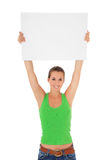 Young woman holding blank white sign Stock Image