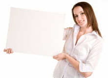 Young Woman Holding a Blank White Sign Stock Image