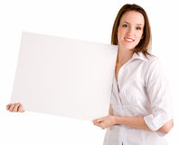 Young Woman Holding a Blank White Sign Royalty Free Stock Image