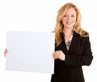 Young Woman Holding a Blank White Sign. A beautiful young woman is holding a blank white sign Stock Photo