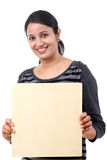 Young Woman holding blank wood sheet Royalty Free Stock Image