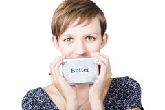 Young woman holding a block of butter Stock Photo